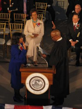 Judge Jimmie Edwards delivers the oath of office to comptroller Darlene Green on April 16, 2013.