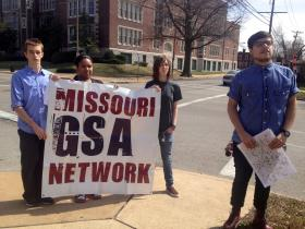 Miguel Plancarte, founding president of the Gay Straight Alliance of McKinley Classical Junior Academy stands at right with his fellow students. The Gay-Straight Alliance Network held a press conference today in opposition to the NRA's proposed measures to combat gun violence in schools.