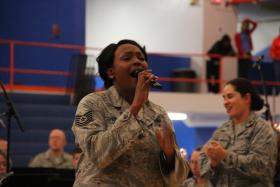 Technical Sergeant Keisha Gwin-Goodin (left) and band leader, Major Cristina Moore Urrutia (right), during an Air Force Band of Mid-America concert at East St. Louis High School
