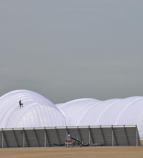 A mobile inflatable hangar was used for the plane because of storm damage to a hangar at Lambert Airport. It's the first time the inflatable hangar has been used by the Solar Impulse team during a mission.