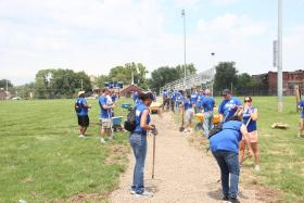 Military veterans and community volunteers put in a new track at the Boys and Girls Club in north St. Louis City.