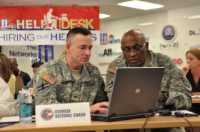 Colonel Mark London and Command Sgt. Maj. Phillip Stringfield of the Georgia National Guard chat with veterans during a Hiring our Heroes event in 2012.