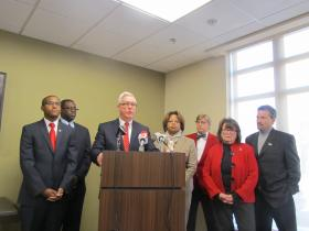 Lt. Gov. Peter Kinder and state Sen. Jamilah Nasheed (tan suit) join other low-income housing supporters at news conference to blast Gov. Jay Nixon.