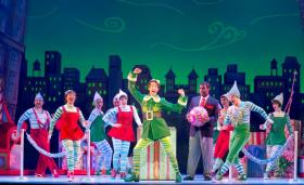 "Matt Kopec (center) and the cast of ""Elf"" at the Fox Theatre."