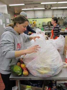 Senior Emily Meingast sorts donations she picked up at Trader Joe's in Brentwood.