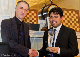 Malcolm Pein presents Hikaru Nakamura his first-place trophy for winning the London Chess Classic.
