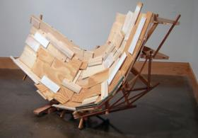 pieces of wood in shape resembling sling chair