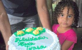 little girl with a birthday cake