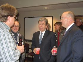 Sen. Roy Blunt, center, mingles Thursday night with St. Charles County officials and business people.