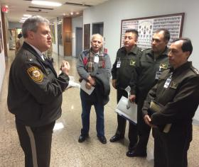 St. Louis County Police Chief Tim Fitch welcomes police officers from Ecuador who visited county police headquarters. Fitch steps down from his post on Friday.