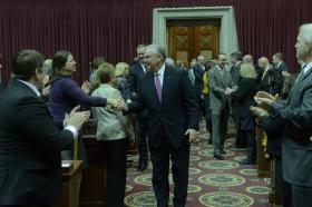 Gov. Jay Nixon greeting legislators before delivering his State of the State address