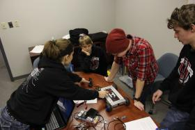 Teenagers work on a designing a remote control car at Hacker U in St. Peters, Mo.