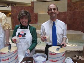 Former state Sen. Jane Cunningham assists Auditor Tom Schweich as he hosts an ice cream social Saturday afternoon.