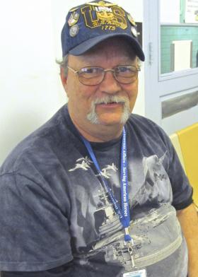St. Louis veteran Ed Rousan volunteers at the lanes.
