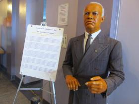 A wax figure of Carter G. Woodson, one of the first scholars of African-American history.