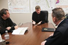 Missouri Attorney General Chris Koster talks with Pattonville Fire Department officials about landfill fire.