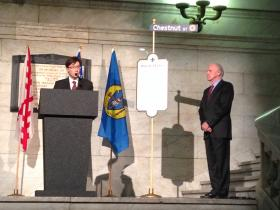 Officials at a 250th anniversary ceremony unveil a historical marker describing St. Louis' early history.