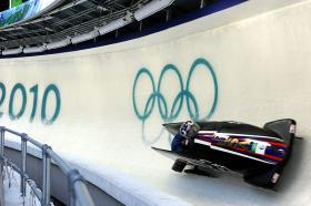 Bobsled pilot Steven Holcomb posts the sixth-fastest time of 51.89 seconds with Curt Tomasevicz aboard USA I in the first heat at Whistler Sliding Center in British Columbia during the 2010 Winter Olympics.