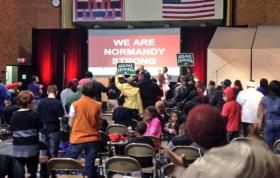 Supporters of the unaccredited Normandy School District rally in the high school gym on March 15, 2014.