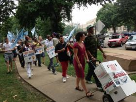 """Supporters of the """"Take Back St. Louis"""" initiative deliver their petitions to the St. Louis election authority on July 31, 2013. A judge on Feb. 11, 2014 halted the April election on the charter change."""