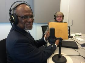 St. Louis County Executive Charlie Dooley holds up his taxes after recording the Politically Speaking podcast.