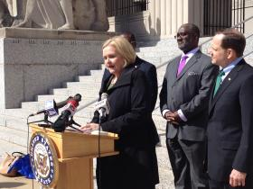 Sen. Claire McCaskill discussed various issues at a news conference Monday with St. Louis Mayor Francis Slay (far right).