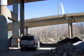 The archeological dig site is two blocks south of the Arch grounds underneath the Poplar Street Bridge.