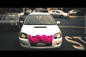 The pink mustache of a Lyft car. They've been forced to stop business in St. Louis for now. But in other places, lawmakers are finding a way to make new car sharing services work.
