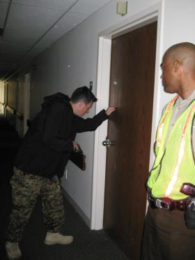 Matthew Caravella, a member of the St. Louis County Police tactical operations unit, pretends to be a gunman looking for victims during an exercise on April 21, 2014.