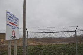 A barbed-wire fence at the West Lake Landfill is intended to keep people out of the areas containing radioactive waste. But Friday's lawsuit alleges that radioactivity has spread off site.
