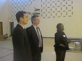 (from left) Kelly Garrett, Richard Barth and Tiara Abu view renovations at the former Mitchell School