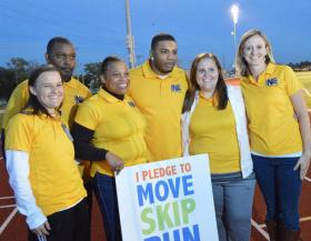 Nelly (third from right) joined city workers and others in the kickoff for the JUMP N2 Shape fitness program last October.