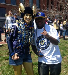 "Rams fans Allison Hasting and Victor Arredon rally with the group ""Keep the Rams in St. Louis"" at Laclede's Landing on April 5, 2014."