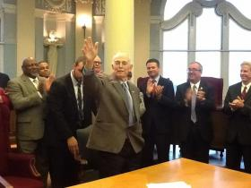 State Rep. Rory Ellinger, D-University City, waves to the audience earlier this month at a bill signing ceremony for HB 1320.