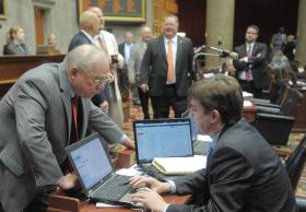 Rep. Ellinger leans over to confer with Rep. Jay Barnes, a Republican from Jefferson City.