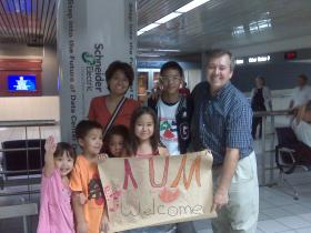 Stephen Rutherford, right, with his wife: Kumiko, and his kids: Nami (10), Alex  (7), Daniel (6), and Sabrina (5) and his son from Thailand (exchange student), Aum (16).