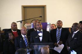 Rev. C. Jessel Strong, president of the Clergy Coalition of Greater St. Louis (center), speaks during a press conference on Monday, April 28.