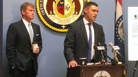 St. Charles County Prosecuting Attorney Tim Lohmar (r) and Missouri Attorney General Chris Koster are charging a man for scamming about $6,000 from people and claiming the money was for the Wounded Warriors Project.