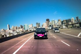 Lyft's cars often have pink mustaches on them. The San Francisco-based company is facing pushback from the regional taxi commission.