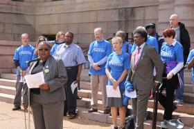 AFT St. Louis President Mary Armstrong speaks at a rally in front of City Hall on Saturday.