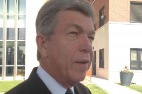 U.S. Senator Roy Blunt of Missouri, talking in front of the St. Louis VA hospital on Wednesday.