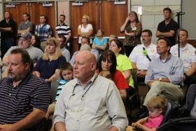 Area residents listen to EPA Regional Administrator Karl Brooks and Bridgeton Mayor Conrad Bowers during a press conference on Friday.