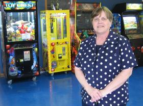"Retired teacher Deb House stands in the game room of her after school club, ""The Refuge,"" in rural Steele, Mo. She has plans to build a larger youth center in downtown Steele."