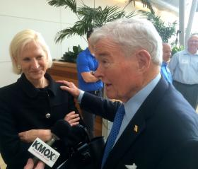 Former U.S. Sen. Kit Bond, R-Mo., and his wife Linda talk to reporters at an event Monday at the Danforth Plant Science Center. Bond was hired by the Missouri Chamber of Commerce to press for Medicaid expansion.