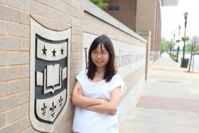 Yinzi Liu stands outside the Washington University medical campus near the Central West End.