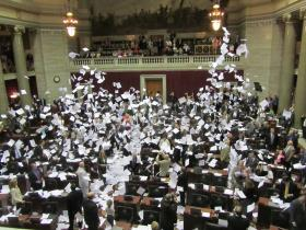 Missouri House celebrates the end of the 2014 session with its traditional paper toss.