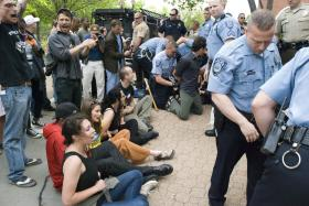 Eight protesters were arrested outside Peabody Energy's annual shareholder meeting in Clayton on Thursday. Two more were arrested inside the hotel.