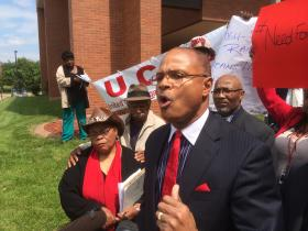 East St. Louis Mayor Alvin Parks speaks Thursday at a high-speed rail rally outside East St. Louis City Hall. Parks wants IDOT to build a high-speed rail station in his city.