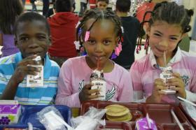 Children from the Ferguson-Florissant School District – a district that does provide summer meals through the USDA's Summer Food Service Program – enjoy a school lunch.