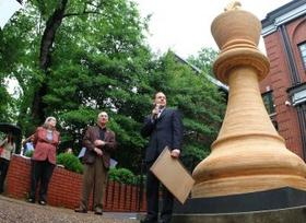 Mayor Frances Slay, with Jeanne and Rex Sinquefield in the background, helped unveil the 14-and-a-half-foot tall World's Largest Chess Piece at the Chess Hall of Fame.
